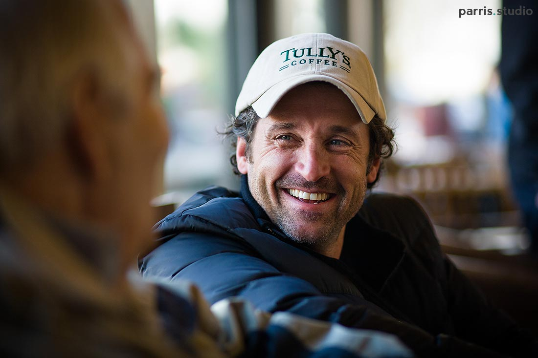 Patrick Dempsey talking to a customer at Tully's
